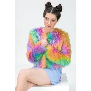 model wears rainbow fur jacket with lolly decorations