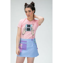 Load image into Gallery viewer, Woman wearing a pink t-shirt with an illustration of hands playing a Nintendo DS holding a cigarette tucked into an purple mini skirt