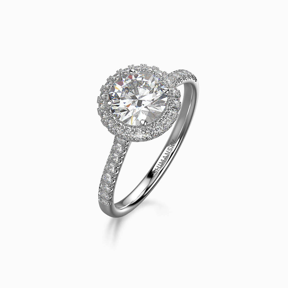 Round Brilliant Halo Ring in Platinum Set With Diamonds