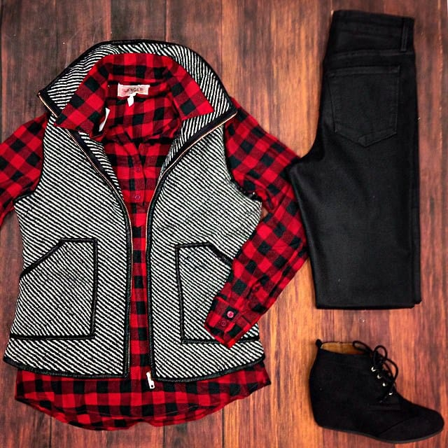 vest and plaid shirt