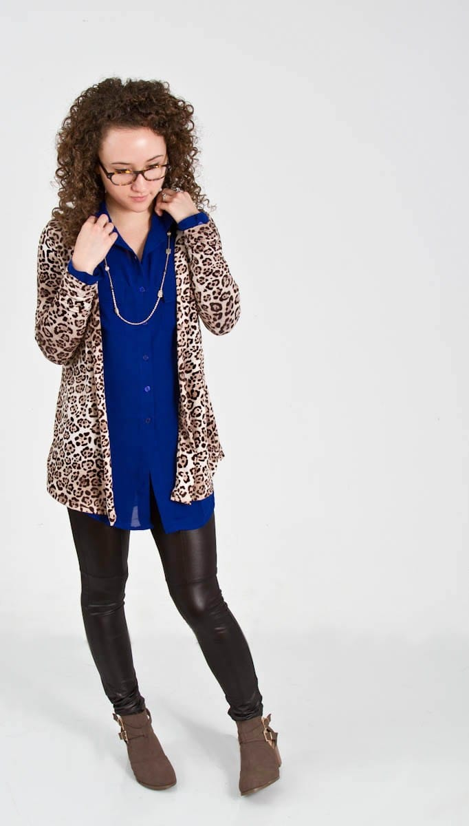 Cheetah Print Cardigan Layered Over Long Collared Blouse with Pleather Leggings