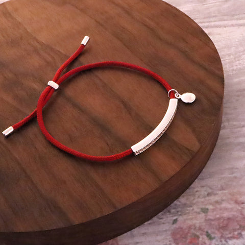 Red String Bracelet with Silver Adornment