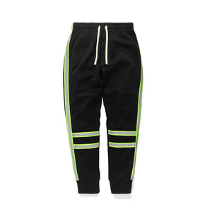 REFLECTIVE STRIPED TRACKPANTS