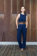 Load image into Gallery viewer, Sleeveless mini print double cloth jumpsuit in 100% cotton. Navy on one side and a cool berry on the inside. Loop button closure with back slit and 2 functional side seam pockets make this the easiest jumpsuit you will wear.