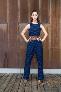 Sleeveless mini print double cloth jumpsuit in 100% cotton. Navy on one side and a cool berry on the inside. Loop button closure with back slit and 2 functional side seam pockets make this the easiest jumpsuit you will wear.