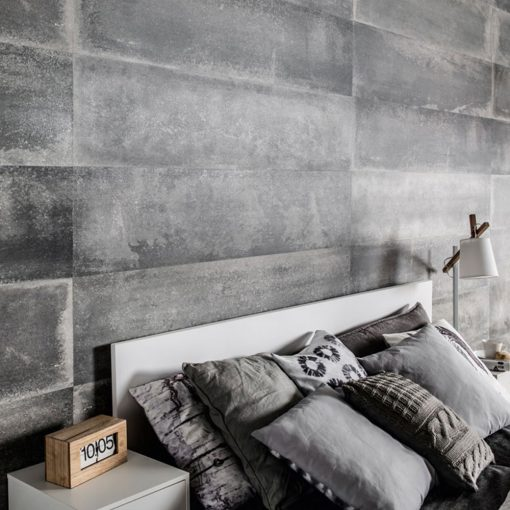 A bed on the background of a wall made of VOX Kerradeco Loft Concrete Wall Panels