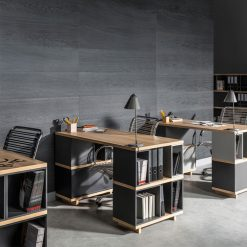 Desks on the background of a wall made of Kerradeco Wood Carbon Wall Panels