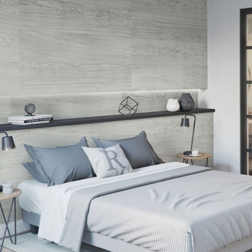 A bed in the bedroom against the wall made of Kerradeco Wood Snowy Wall Panels