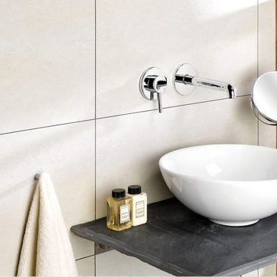 Bathroom sink on the background of the wall made of Dumawall Singlefix Tile Beige Panels