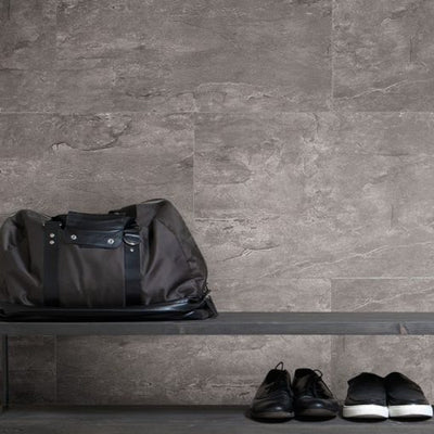 shoes and bag against the background of a wall made of Dumawall Singlefix Tile Lille Panels