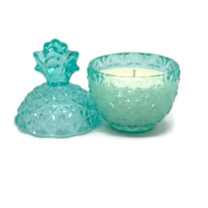 Pina Colada scented soy candle in teal pineapple jar