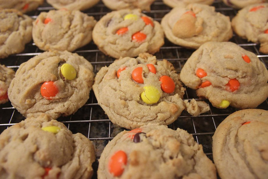 Combination peanut butter chip chocolate chip cookies with reese's pieces on top
