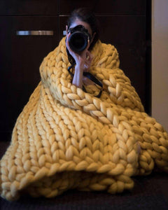 Yellow chunky knitted blanket