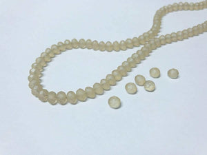 Facettierte Glasperlen Disc 6 x 4 mm, Farbe 20 matt champgane/white opal - bead&more