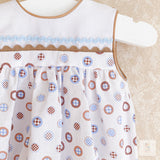 Ezra tan and blue circle pattern romper