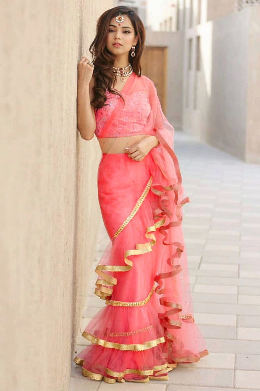 aab8e1367ff76b Attractive Coral Pink Net Fabric Ruffle Style Saree With Heavy Blouse -  MAJISHARS101
