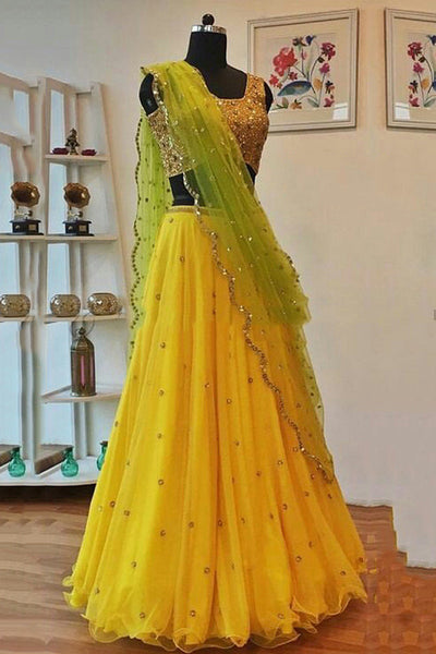 Lovely Yellow Designer Partywear Designer Net Lehenga Choli