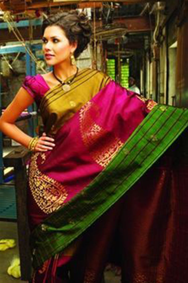Desiring Rani Pink and Green Colored Silk Base Kairy Pattern Saree