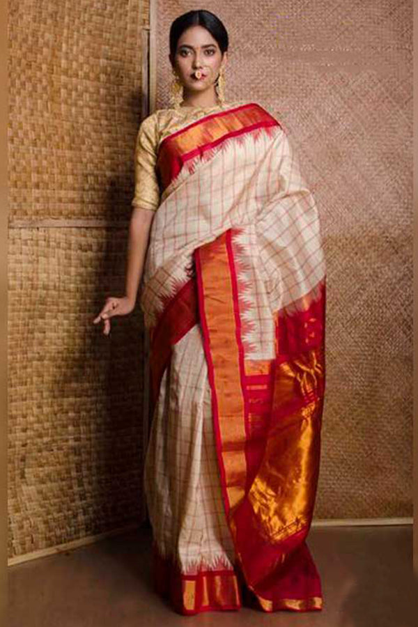 Charming Light Cream Colored Red Gold Pallu Silk Base Saree With Tassels