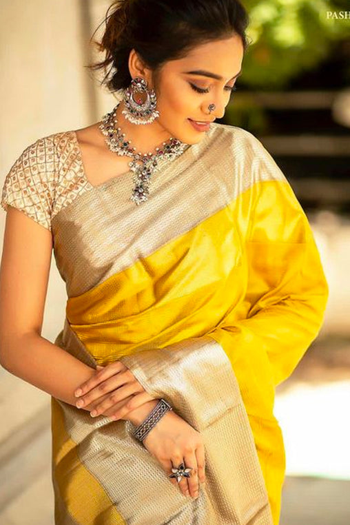 Radiant Yellow and Gold Soft Silk Saree