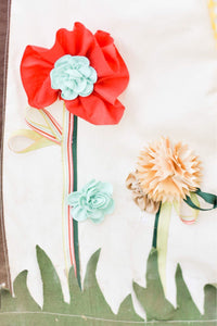fabric and silk flowers and grass by LoveMeSparkle