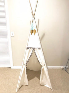 white and grey children's gender neutral tee pee