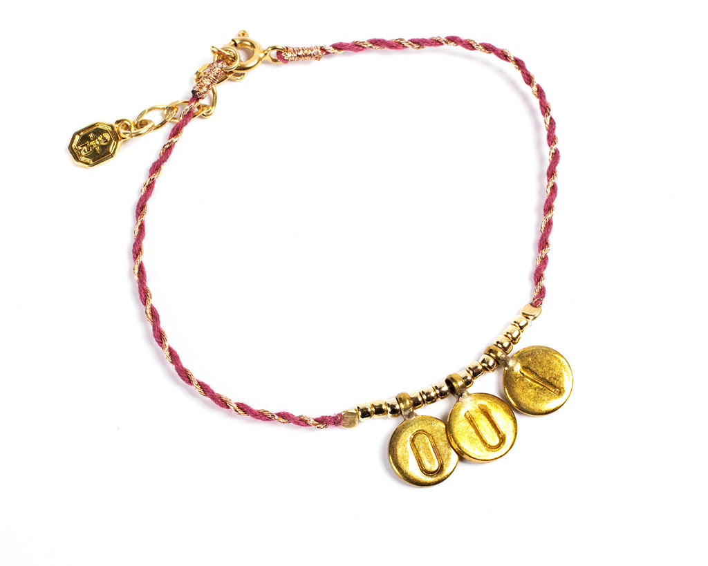 Bracelet with cord and medals. Oui - 003