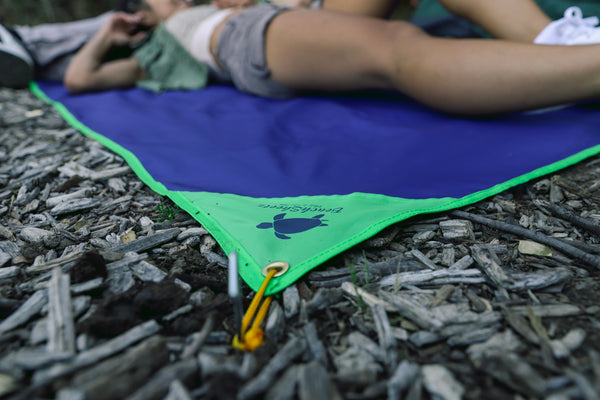Grounds stakes being used on the BeachSheetz Outdoor Blanket