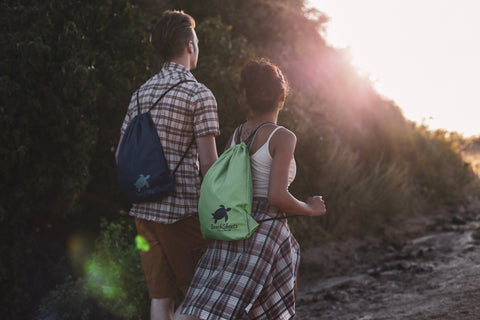 Young couple hiking in Santa Monica with their camp blankets