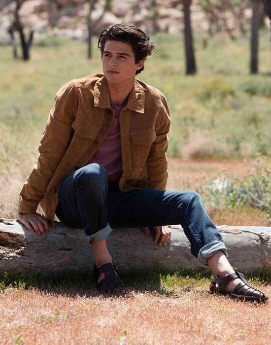 a male model wearing Jerusalem Sandals Barak in brown  at Joshua tree park