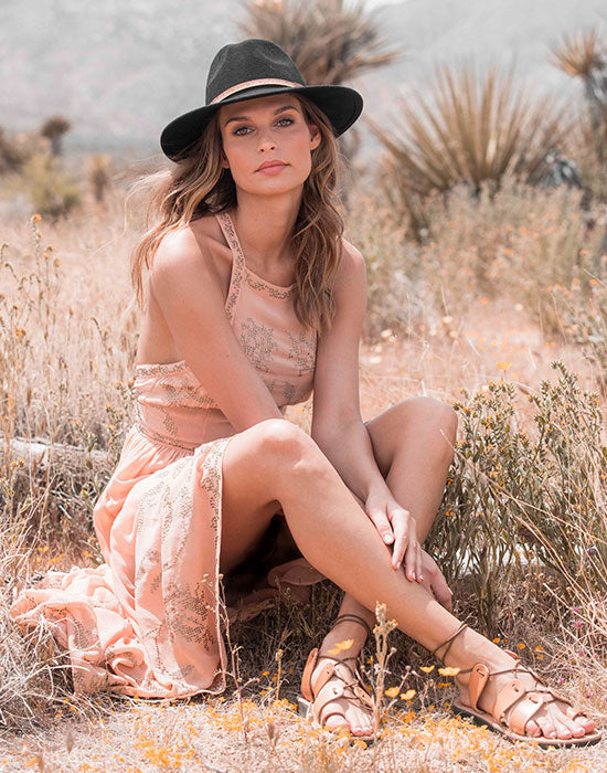 a female model wearing Jerusalem Sandals Deborah in Tan at Joshua tree park