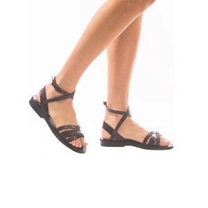 Model wearing Asa brown, handmade leather sandals with back strap