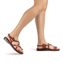 Load image into Gallery viewer, The Good Shepherd Buckle honey, handmade leather sandals with back strap and toe loop - Model View