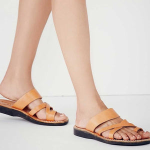 The Good Shepherd tan, handmade leather slide sandals with toe loop - on feet View