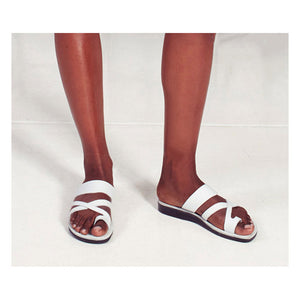 The Good Shepherd white, handmade leather slide sandals with toe loop - Side View