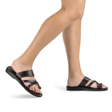 Load image into Gallery viewer, Model wearing The Good Shepherd brown, handmade leather slide sandals with toe loop