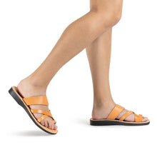 Load image into Gallery viewer, The Good Shepherd tan, handmade leather slide sandals with toe loop - model View