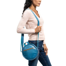Load image into Gallery viewer, Round Leather Bag in blue - model View