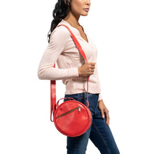 Load image into Gallery viewer, Round Leather Bag in red - model View