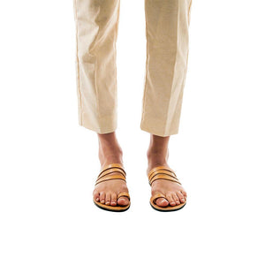 Model wearing Angela tan, handmade leather slide sandals with toe loop
