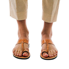 Load image into Gallery viewer, Model wearing Ara tan, handmade leather slide sandals with toe loop