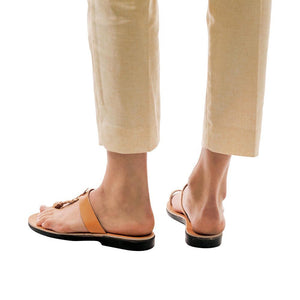 Model wearing Ara tan, handmade leather slide sandals with toe loop