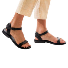 Load image into Gallery viewer, Model wearing Arden black, handmade leather sandals with back strap