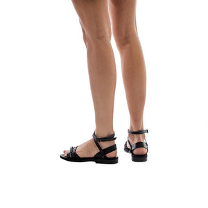 Model wearing Asa black, handmade leather sandals with back strap