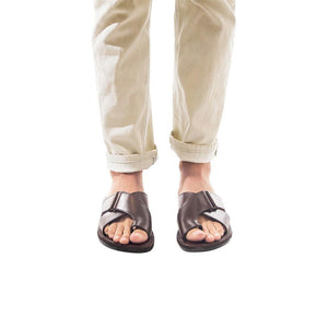 Model wearing Asher brown, handmade leather slide sandals with toe loop