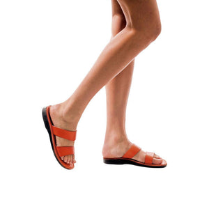 Model wearing Aviv orange, handmade leather slide sandals