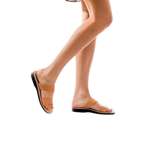Model wearing Aviv tan, handmade leather slide sandals