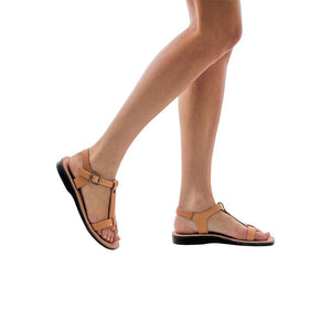 Model wearing Bathsheba tan, handmade leather sandals with back strap