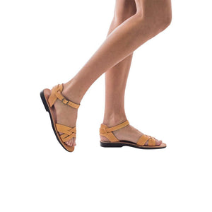 Model wearing Chloe tan, handmade leather sandals with back strap