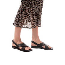 Load image into Gallery viewer, Model wearing Elan Buckle black, handmade leather sandals with back strap - Front View